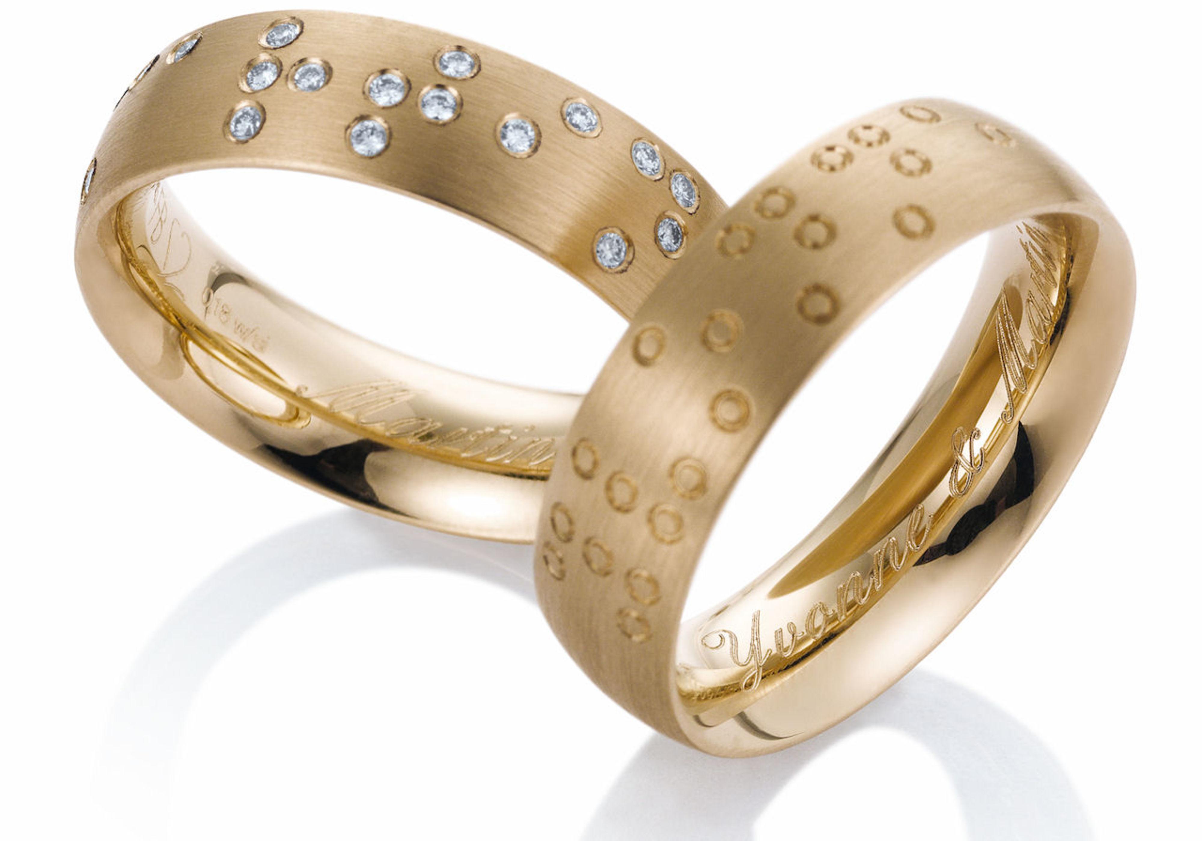 Breuning trouwringen met braille